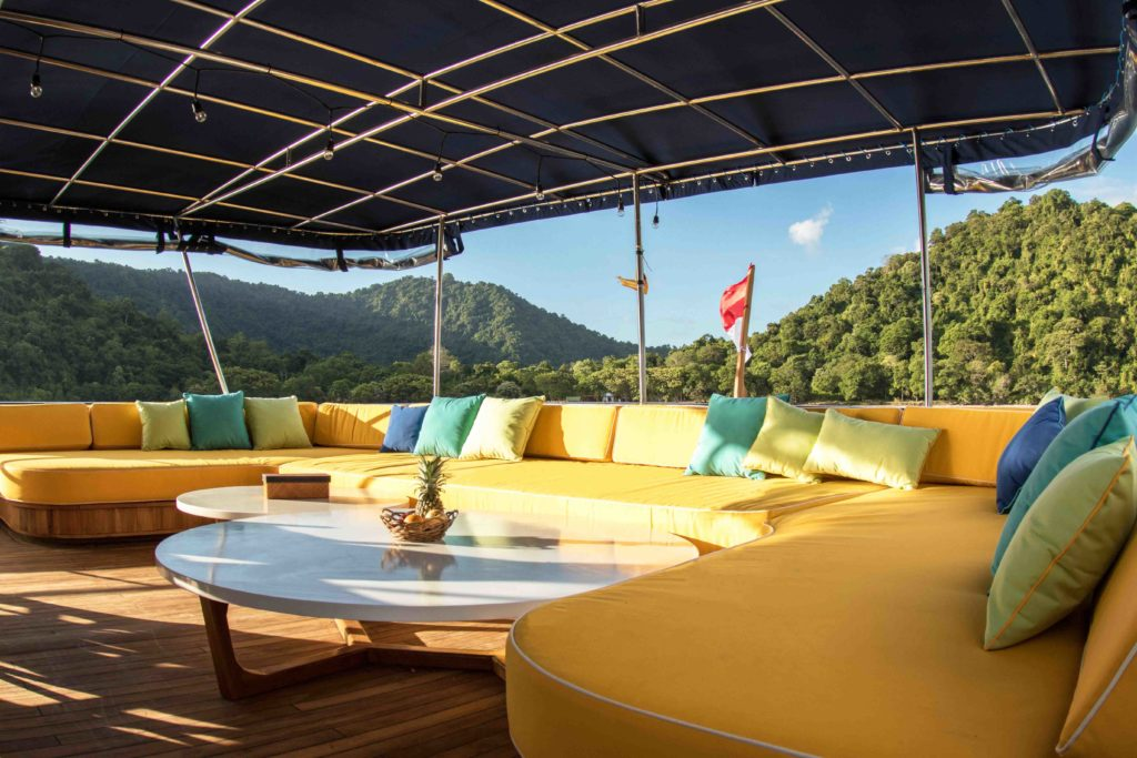 Outdoor lounge on the stern deck of Magia 2 liveaboard