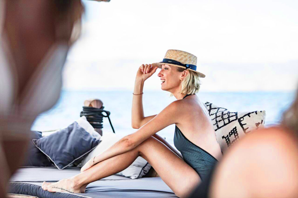 A woman enjoying a boat trip